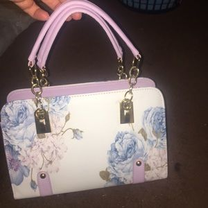 Purse with carry handles and shoulder strap.  New